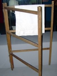 Wooden clothes horse, turned sideways covered in a blanket made an indoor tent!