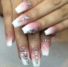 Pink and white ombre nails with a beautiful rhinestone touch.