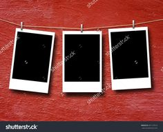 Close-up of three rectangular blank instant photo frames hanged by pegs against red concrete wall background
