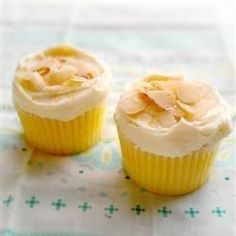 These light, lemony cupcakes, made from scratch, have a fluffy whipped cream icing.