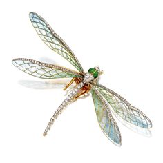 ART NOUVEAU PLIQUE-À-JOUR ENAMEL AND DIAMOND DRAGONFLY BROOCH, CIRCA 1900. Mounted en tremblant, formed of plique-à-jour enamel in pastel shades of blue and green and edged in rose-cut diamonds, the head and body decorated with old-mine diamonds and translucent apple green enamel, mounted in gold,
