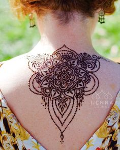 back mehndi design tattoo in floral