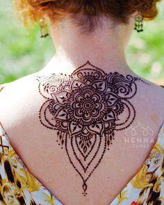 back mehndi design tattoo in floral