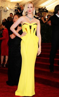 January Jones opted for bold color in a custom canary yellow Atelier Versace peplum gown with metallic insets. She contrasted the hue with a vintage Cartier yellow gold, diamond, and turquoise necklace.