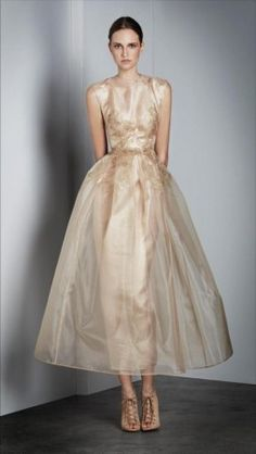 Alex Perry. An airy beige gold. Feels like Light or True Spring. Interesting style and beautiful.