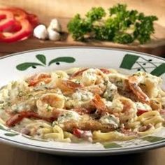 Olive Gardens newest entree, Chicken Shrimp Carbonara, was inspired during the chefs recent trip to the Italian region of Rome. The menu item and recipe combines chicken and shrimp with bucatini pasta in a pancetta and parmesan cream sauce. Pasta Carbonara, Chicken And Shrimp Carbonara, Bucatini Pasta, Shrimp Pasta, Baked Shrimp, Restaurant Recipes, Seafood Recipes, Chicken Recipes, Dinner Recipes