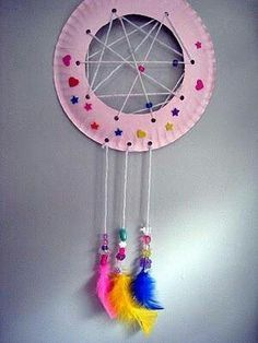 Paper plate dream catcher. Native American week. Walk to totem pole park.