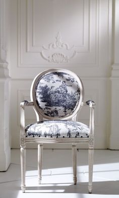 Blue toile upholstery on antique accent chair by Ethan Allen