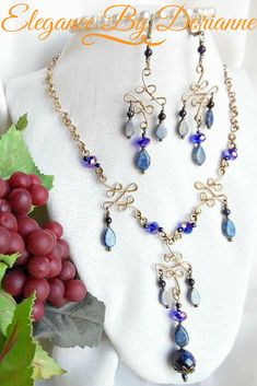 Fabulous and Exquisite Blue Lapis and Gold Stone Victorian Style Necklace and Earring Set! Beautifully created with graceful handmade filigree wire work links, and handmade petite chain links in red brass wire! The center filigree pendant of the necklace is adorned with a magnificent glimmering faceted blue gold stone drop, cradled by an antique brass floral bead cap. #elegancebydorianne #victorianstyle #jewelry #jewellery #lapislazuli #goldstone #etsyjewelry #etsyshop #customjewelry…