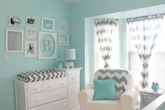 Love the frames over the changing table, the chevron, and that shade of blue is lovely even though I want a grey nursery.  Also, where can I buy that elephant lamp!?
