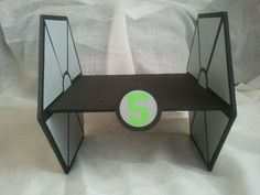 Star Wars Tie Fighter cupcake stand created for a 5 year old birthday party.  Made by Paper Recollections.  Paper Recollections on Facebook or www.paperrecollections.com