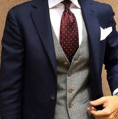 navy blue blazer. white oxford. gray waistcoat. maroon tie w/white pin dots. white pocket square. color combo. southern. style.