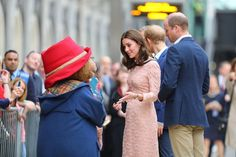 Kate Middleton shows off her baby bump as she glows in pink at surprise appearance with Prince William and Harry - Mirror Online