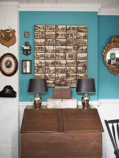 Great use of vintage postcards by antiques dealer Sean Scherer. Love this with the bold wall color!