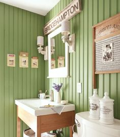 """""""Our bathroom walls—painted Bunker Hill by Benjamin Moore—were inspired by green planks we found lurking under the upstairs carpeting,"""" says Chris. """"I love the camp lodge vibe!"""""""