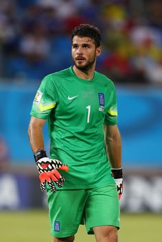 Orestis Karnezis Photos - Orestis Karnezis of Greece looks on during the 2014 FIFA World Cup Brazil Group C match between Japan and Greece at Estadio das Dunas on June 2014 in Natal, Brazil. - Japan v Greece: Group C Soccer Baby, Soccer Guys, Fifa, Greek Men, Sports Models, Goalkeeper, Football Players, Cute Guys, My Hero
