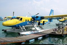 Moored at sea plane terminal A, poised for her next flight to one of the many islands that make up the Maldives ferrying tourists and hotel workers. Trans Maldivian Airways - TMA De Havilland Canada DHC-6-300 Twin Otter 	 Male - International (MLE / VRMM) Maldives, March 9, 2014
