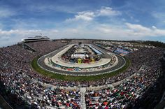 RIDGEWAY, VA - APRIL 07: Cars race during the NASCAR Sprint Cup Series STP Gas Booster 500 on April 7, 2013 at Martinsville Speedway in Ridgeway, Virginia. (Photo by Mark Wilson/Getty Images)