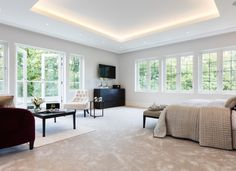 LED ribbon in the coffered celing provides a gentle, glare free light that's easy to live with as the light source in concealed.  Ceiling downlights provide highlighting.