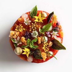 Tomato lobster disc garnished with croutons, chervil, chive tips, lemon gel, bonito mayonnaise, tomato flowers, fennel flowers, and basil by chef @danielhumm of Eleven Madison Park, in NYC. by @francescotonelli #TheArtOfPlating