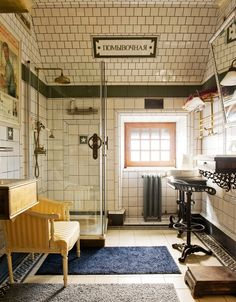 """Back in the ('30s) U.S.S.R. """"The sign in the bathroom reads """"washroom."""" The handles on the shower doors are submarine valves, found at a Moscow flea market. The stool is from the Netherlands."""""""