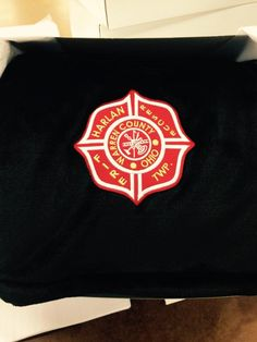 Harlan County Fire & Rescue embroidered patch on our Luster Loft throw  blankets in Black.
