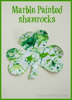 Marble painting shamrocks for St. Patrick's Day. A fun & low mess painting technique for all ages.