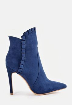 A Victorian inspired faux suede bootie with a ruffled detail, inner zip closure, and covered block heel....