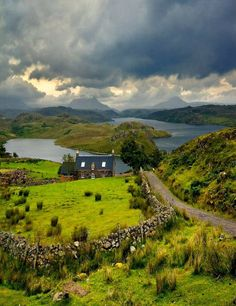 The Highlands, Scotland: stone cottage, the loch, and stone fences - just what one would imagine.