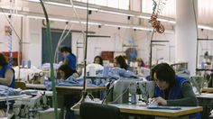 Seamstresses working on the ASKET oxford shirt.