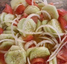 3 Tomatoes, 3 cucumbers, 1 onion, 1/2 cup apple cider vinegar, 1 teaspoon of cracked pepper, 2 table spoons of sugar (TOTALLY YOUR CHOICE), 2 teaspoons of salt, 1 cup of water, 1/4 cup of olive oil, mix well...thats it. Let it chill for 1-2 hours... That simple.