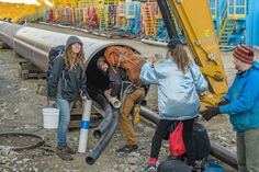 Four Water Protectors Crawl Inside Pipe to Stop Construction of Spectra Energy's AIM Pipeline, on Indigenous Peoples' Day Defenders take action along the Hudson to halt plans to pull AIM pipeline under the river. The protectors have been inside the pipeline for more than seven hours and continue to sustain the occupation. Two support people were also arrested on site and charged with criminal trespass; a third support person was arrested on public property merely on suspicion of illegal…