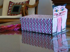 Cat shoe box lined with paper tail tissue. The cat face is a reproduction of Aldemir Martins painted with chalk oil (Pentel).