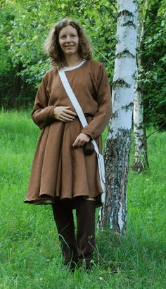 Bocksten     full reconstruction of garment found in Bocksten (Sweden). Surviving pieces are woolen hose, tunic, cloak and hood. The Bocksten tunic is one of the best preserved tunics in Europe.   Dress is entirely hand sewn. (half of 14th century)