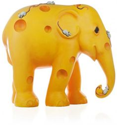 "Saffron Painted by Ellen Steward Exhibited in: London 2010 ""A western world stigma attached to elephants is that they are scared of mice. Although probably inaccurate, this was the inspiration for my design and mouse's love of cheese contributed to the elephants's holey form."""