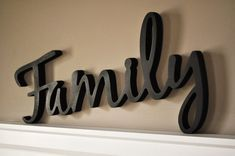 """This """"word art"""" wood cutout is a great addition to any home whether or not you're building a new family or have already been established. This piece is cut out MDF and measures 20"""" long by 10"""" at the tallest point and is 1/2"""" thick. The lightweight nature of this piece allows it to be hung using very small nails. Available in Black, White, Espresso Brown, or Cream."""
