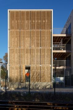 Image 7 of 46 from gallery of Social Housing + Shops in Mouans Sartoux / Comte & Vollenweider. Photograph by Milèle Servelle Bamboo Architecture, Facade Architecture, Shop Front Design, House Design, Wooden Facade, Bamboo House, Bamboo Design, Social Housing, Shop House Plans
