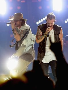 Tyler Hubbard Photos Photos - Brian Kelly and Tyler Hubbard of Florida Georgia Line perform during their Dig Your Roots 2016 Tour at Bridgestone Arena on October 13, 2016 in Nashville, Tennessee. - Florida Georgia Line Dig Your Roots 2016 Tour - Nashville, Tennessee