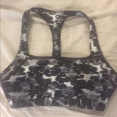 Athleta snow leopard bra Black and white leopard bra only worn once and didn't sweat in it . Comes with a cute cut out back Intimates & Sleepwear Bras