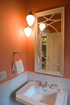 ? Click to see how they turned the attic into a beautiful bedroom! #bathroom #orange #sink #paint #color #mirror #homeinspiration #design #decorClick to check a cool blog!