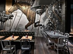 Design studio spinoff has completed the interiors for a gourmet burger restaurant in Hong Kong.