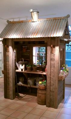 Potting shed (love the watering can on top