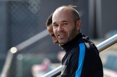 Barcelona's midfielder Andres Iniesta smiles as he arrives for a training session at the Sports Center FC Barcelona Joan Gamper in Sant Joan Despi, near Barcelona on April 4, 2016, on the eve of the UEFA Champions League quarter finals first leg football match FC Barcelona vs Atletico de Madrid.