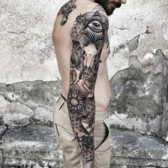 Hinduism themed black ink sleeve tattoo of various mystical ornaments and goat skull
