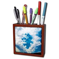 A cool shape in the clouds with blue coming through from the sky Tile Pen Holder