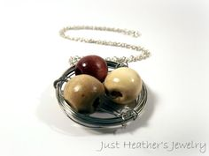 $21 - www.etsy.com/shop/JustHeathersJewelry - Bird's nest necklace - wire wrapped - large wooden beads - birdnest - robins egg nest - wood - gift idea - handmade necklace. Use coupon code PINS15 for 15% off your total purchase.