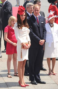 "July 1, 2011: Kate wears the Reiss ""Nanette"" dress and a custom maple leaf fascinator on Canada Day. She previously wore this dress in her official engagement photo."