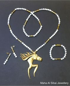 Handmade horse designed by Amal Al Zahrani from Kingdom of Saudi Arabia.  Sculptured and manufactured in Maha Al Sibai Jewellery. Gold+Diamond+White Jade  Now Available in Maha Al Sibai Jewellery, Wafi Mall, Dubai,UAE