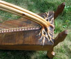 Rivendale harp - by Mountain Glen Harps.  Exquisite - but how does he mount the pillar to the soundboard?