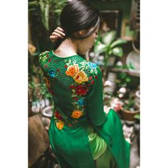 Green Ao Dai (Vietnamese traditional dress) with beautifully embroidered flowers. Includes satin pants.